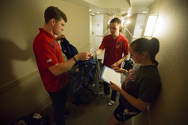 Kansas basketball student managers Tim Skoch, left, Jay Turnipseed and Emily Tyler take inventory of all the uniforms and gear they have picked up to be laundered, Monday night at the Westin Maui in Lahaina, Hawaii  following the Jayhawks' 123-72 win over Chaminade.