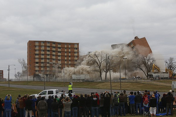 KU's McCollum Hall comes crashing down during a planned demolition on Wednesday, Nov. 25, 2015.