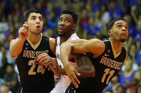 Kansas forward Jamari Traylor (31) tangles with Vanderbilt guard Nolan Cressler (24) and Vanderbilt forward Jeff Roberson (11) during the second half, Wednesday, Nov. 25, 2015 at Lahaina Civic Center in Lahaina, Hawaii.