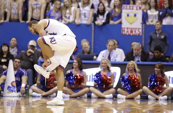Kansas forward Perry Ellis (34) puts his shoe back on after losing it during the first half, Tuesday, Dec. 1, 2015 at Allen Fieldhouse.