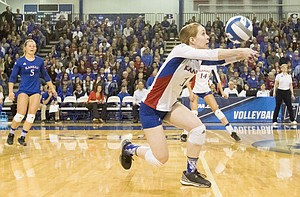 Kansas senior Anna Church (1) keeps the ball in play off a block during Kansas' second round NCAA volleyball tournament match against Missouri on Friday night at the Horejsi Center. The Jayhawks sent the Tigers packing with a three set sweep.