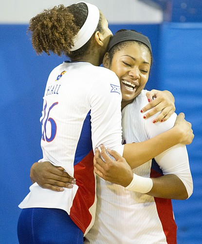 Kansas senior Tiana Dockery, right, receives a hug from teammate, junior Janae Hall following Kansas' second round NCAA volleyball tournament match against Missouri on Friday night at the Horejsi Center. The Jayhawks sent the Tigers packing with a three set sweep.