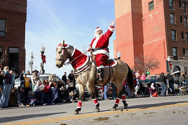 Santa Claus rides horseback down Massachusetts St. to end the Lawrence Old-Fashioned Christmas Parade Saturday, Dec. 5, 2015.