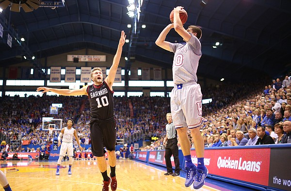Kansas guard Sviatoslav Mykhailiuk (10) pulls up from the corner for three against Harvard guard Patrick Steeves (10) during the first half, Saturday, Dec. 5, 2015 at Allen Fieldhouse.