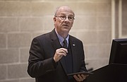 Kansas University professor and University Senate President Mike Williams moderates an information session about guns on campus Tuesday, Dec. 8, 2015, in KU's Budig Hall.
