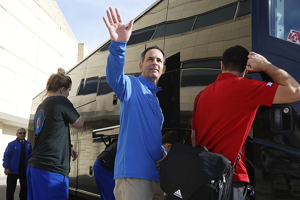 KU volleyball coach Ray Bechard waves to the crowd on Wednesday Dec. 9, 2015, as the team left form Horejsi Family Athletics center, and boarded a bus to the airport, as the Jayhawks head to San Diego for the Sweet 16, against Loyola Marymount on Friday.