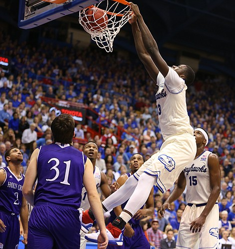 Kansas forward Cheick Diallo (13) throws down a dunk against Holy Cross during the second half, Wednesday, Dec. 9, 2015 at Allen Fieldhouse.