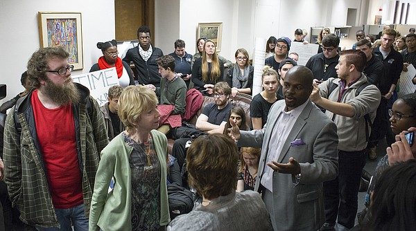 E. Nathan Thomas III, Kansas University Vice Provost for Diversity and Equity, right, speaks to a group of student protesters gathered inside the administration offices at Strong Hall, Wednesday, Dec. 9, 2015.
