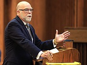 Attorney Pedro Irigonegaray makes oral arguments before the Kansas Supreme Court in Topeka, Kan., Thursday, Dec. 10, 2015. The high court heard arguments about a 2014 law that strips it of its authority to appoint the chief judges in the state's 31 judicial districts and gives it to local judges.