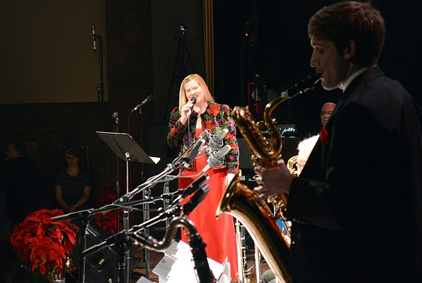 Singer Kathleen Holeman first performed at the KPR Big Band Christmas show in 2014 and returns for Saturday night's performance. The saxophone section of the Kansas City Jazz Orchestra is pictured here as Holeman sings.