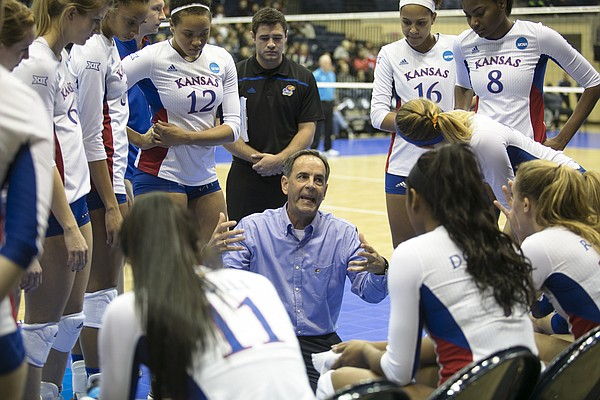 Kansas head coach Ray Bechard speaks with the team during a timeout Friday night in San Diego.