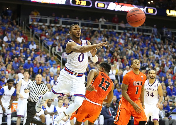 Kansas guard Frank Mason III (0) wings a pass across the baseline around Oregon State guard Langston Morris-Walker (13) during the second half, Saturday, Dec. 12, 2015 at Sprint Center.