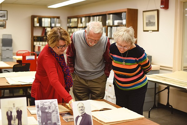 Kansas University Archivist Rebecca Schulte (left), Jim Naismith and his wife, Beverly Naismith, look over James Naismith items at KU's Spencer Research Library during a visit by the Naismith's to Lawrence. Jim Naismith of Portland, Texas, is the grandson of James Naismith, inventor of basketball and a former KU basketball coach and athletics director.