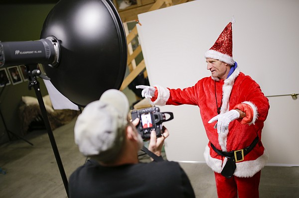Lawrence photographer John Clayton reviews an image during a Christmas card photo shoot with legendary Lawrence figure Dennis Abbott at the Lawrence Community Photo Studio, 720 E. Ninth Street Suite 6, on Thursday, Dec. 17, 2015. Clayton has been photographing Abbott for years in all varieties of Lawrence settings and locations.