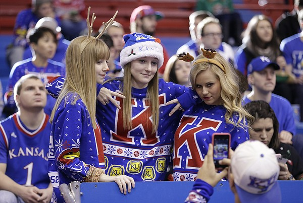 Kansas University sophomores Kelley Sharp, left, and her twin sister Amanda Sharp, Olathe, and Taylor Horvat, Olathe junior, put on their game faces for an ugly Christmas sweater group photo by Jordan Bosch, Clay Center, Kan. junior, Saturday, Dec. 19, 2015 at Allen Fieldhouse.