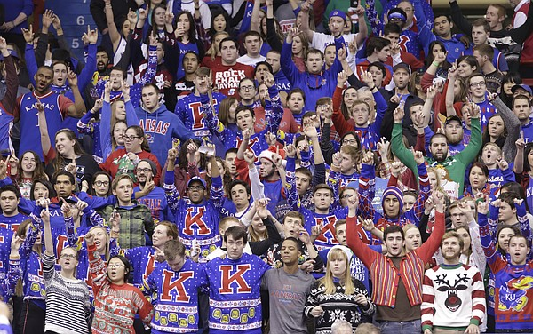 A sea of ugly Christmas sweaters come together for the Alma Mater during the first half, Saturday, Dec. 19, 2015 at Allen Fieldhouse.