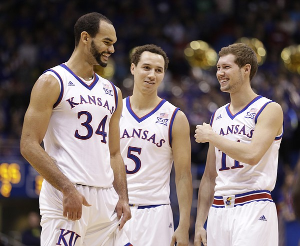 Kansas players Perry Ellis, left, Evan Manning and Tyler Self have a laugh late in the game.