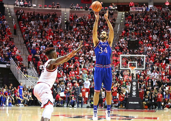 Kansas forward Perry Ellis (34) puts up a three against San Diego State forward Zylan Cheatham (14) during the first half, Tuesday, Dec. 22, 2015 at Viejas Arena in San Diego.