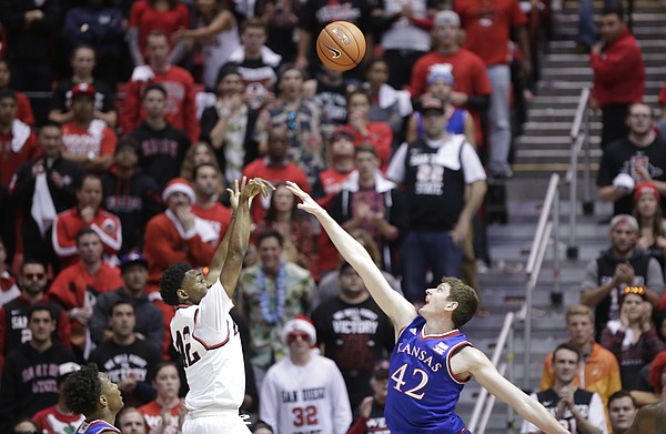San Diego State guard Jeremy Hemsley (42) puts a shot over Kansas forward Hunter Mickelson (42) during the first half, Tuesday, Dec. 22, 2015 at Viejas Arena in San Diego.