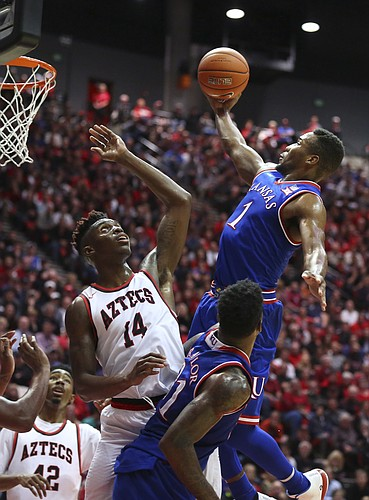 Kansas guard Wayne Selden Jr. (1) floats in for a bucket over San Diego State forward Zylan Cheatham (14) during the second half, Tuesday, Dec. 22, 2015 at Viejas Arena in San Diego.