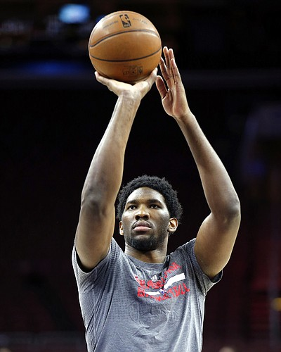 Philadelphia 76ers' Joel Embiid shoots during warmups before his team plays the New York Knicks, Friday, Dec. 18, 2015, in Philadelphia. (Yong Kim/The Philadelphia Inquirer via AP)