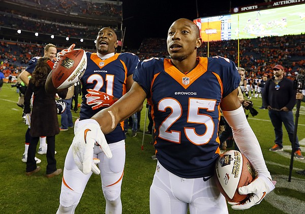 Denver Broncos cornerback Chris Harris (25) and Denver Broncos cornerback Aqib Talib (21) celebrate after an NFL football game against the Green Bay Packers, Sunday, Nov. 1, 2015, in Denver. The Broncos won 29-10 to improve to 7-0. (AP Photo/Joe Mahoney)