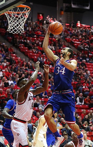 Kansas forward Perry Ellis (34) gets up for a bucket against San Diego State forward Zylan Cheatham (14) during the second half, Tuesday, Dec. 22, 2015 at Viejas Arena in San Diego.