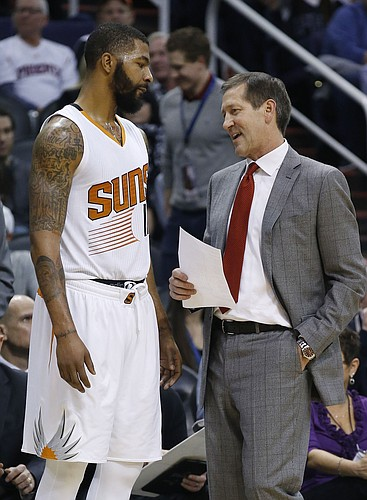 Phoenix Suns head coach Jeff Hornacek, right, talks with Markieff Morris, left, during the first half of an NBA basketball game against the Denver Nuggets Wednesday, Dec. 23, 2015, in Phoenix. (AP Photo/Ross D. Franklin)