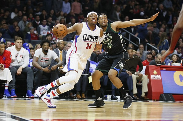 Los Angeles Clippers' Paul Pierce, left, dribble against Milwaukee Bucks' Jabari Parker during the first half of an NBA basketball game, Wednesday, Dec. 16, 2015, in Los Angeles. (AP Photo/Danny Moloshok)