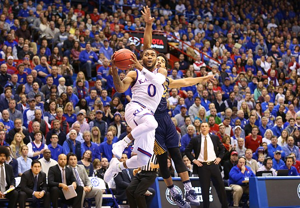 Kansas guard Frank Mason III (0) gets to the bucket past UC Irvine guard Aaron Wright (32) during the first half, Tuesday, Dec. 29, 2015 at Allen Fieldhouse.