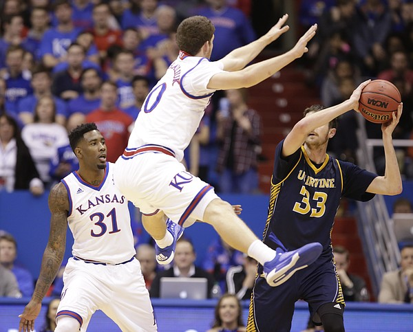 Kansas guard Sviatoslav Mykhailiuk (10) and forward Jamari Traylor (31) try to trap UC Irvine forward Mike Best (33) during the second half, Tuesday, Dec. 29, 2015 at Allen Fieldhouse.