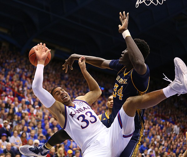 Kansas forward Landen Lucas (33) is sent to the floor after a block by UC Irvine center Mamadou Ndiaye (34) during the second half, Tuesday, Dec. 29, 2015 at Allen Fieldhouse.