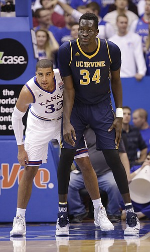 Kansas forward Landen Lucas (33) and UC Irvine center Mamadou Ndiaye (34) work for position during the second half, Tuesday, Dec. 29, 2015 at Allen Fieldhouse.
