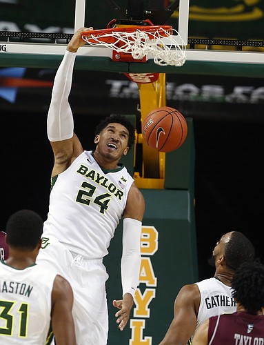 Baylor guard Ishmail Wainright (24) scores over New Mexico State in the second half of an NCAA college basketball game, Wednesday, Dec. 23, 2015, in Waco, Texas. (AP/Rod Aydelotte)