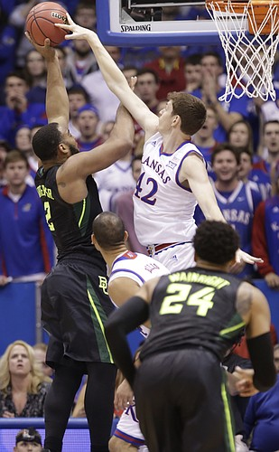 Kansas forward Hunter Mickelson (42) gets a hand on a shot by Baylor forward Rico Gathers (2) during the first half, Saturday, Jan. 2, 2016 at Allen Fieldhouse.