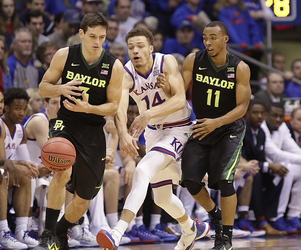 Kansas guard Brannen Greene (14) knocks the ball away form Baylor guard Jake Lindsey (3) during the first half, Saturday, Jan. 2, 2016 at Allen Fieldhouse. At right is Baylor guard Lester Medford (11).