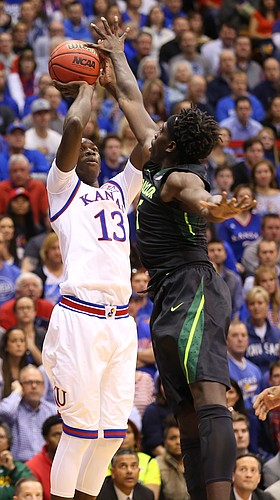 Kansas forward Cheick Diallo (13) puts up a shot over Baylor forward Johnathan Motley (5) during the first half, Saturday, Jan. 2, 2016 at Allen Fieldhouse.