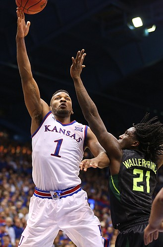 Kansas guard Wayne Selden Jr. (1) hangs for a shot against Baylor forward Taurean Prince (21) during the second half, Saturday, Jan. 2, 2016 at Allen Fieldhouse.