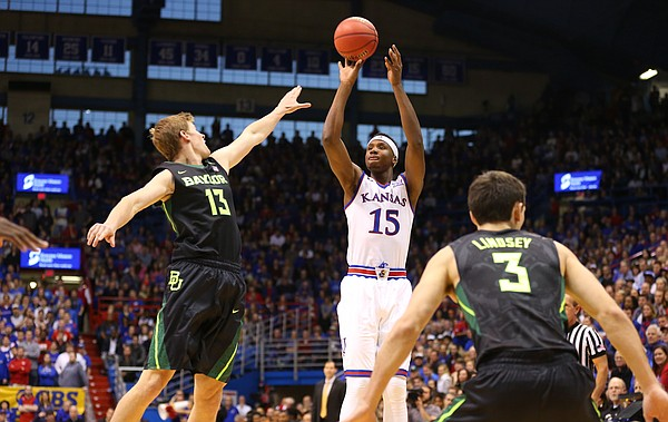 Kansas forward Carlton Bragg Jr. (15) puts up a three against Baylor forward John Heard (13) during the second half, Saturday, Jan. 2, 2016 at Allen Fieldhouse.