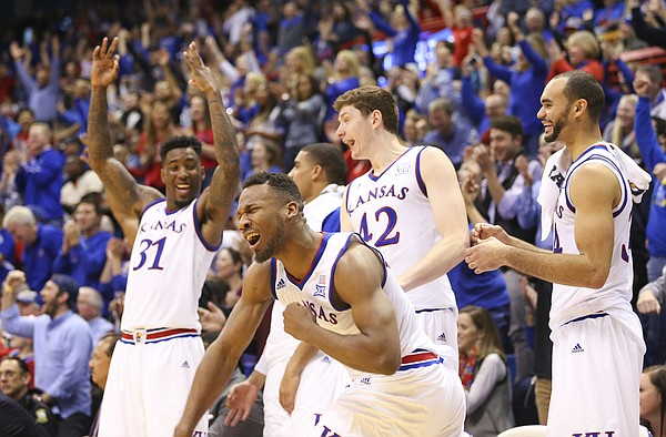 Kansas guard Wayne Selden Jr. (1) pumps his fist in celebration with the Jayhawks' bench after a late three by teammate Lagerald Vick during the second half, Saturday, Jan. 2, 2016 at Allen Fieldhouse.