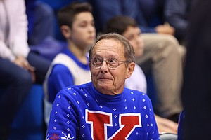 Dana Anderson sits courtside before the Kansas University men's basketball game Monday at Allen Fieldhouse.