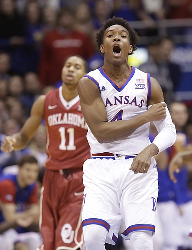 Kansas guard Devonte' Graham (4) pumps his fist after coming away with a steal and a foul by the Sooners during the first half, Monday, Jan. 4, 2016 at Allen Fieldhouse.