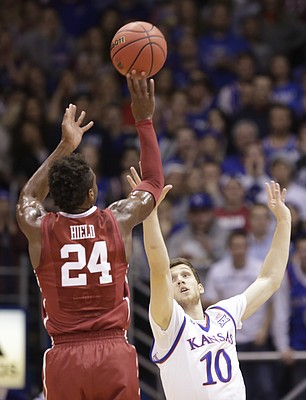 Oklahoma guard Buddy Hield (24) puts a shot over Kansas guard Sviatoslav Mykhailiuk (10) during the first half, Monday, Jan. 4, 2016 at Allen Fieldhouse.