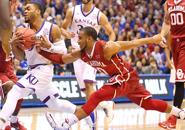 Kansas guard Frank Mason III (0) drives against Oklahoma guard Jordan Woodard (10) during the first half, Monday, Jan. 4, 2016 at Allen Fieldhouse.