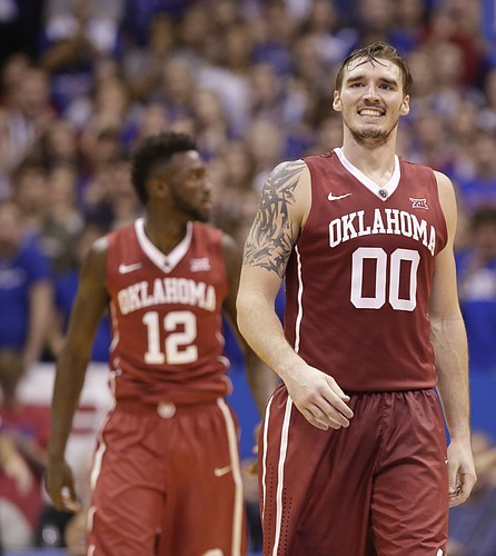 Oklahoma forward Ryan Spangler (00) grimaces after picking up a foul during the second half, Monday, Jan. 4, 2016 at Allen Fieldhouse.