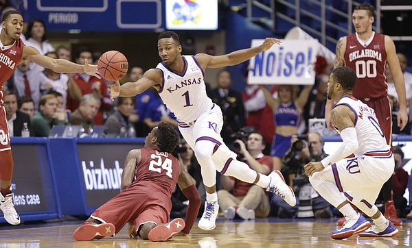 Kansas guard Wayne Selden Jr. (1) strips a ball from Oklahoma guard Buddy Hield (24) during the second half, Monday, Jan. 4, 2016 at Allen Fieldhouse.