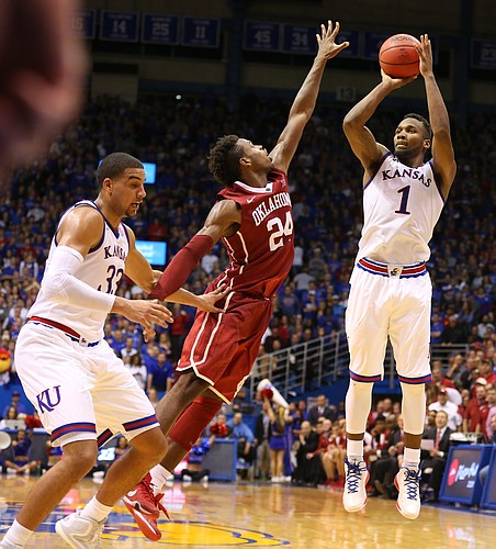 Kansas guard Wayne Selden Jr. (1) is fouled by Oklahoma guard Buddy Hield (24) on a three during third overtime, Monday, Jan. 4, 2016 at Allen Fieldhouse.