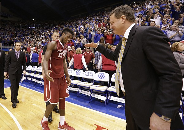 Kansas head coach Bill Self comes in to slap hands and hug Oklahoma guard Buddy Hield (24) following the Jayhawks' 109-106 triple overtime win over the Sooners.