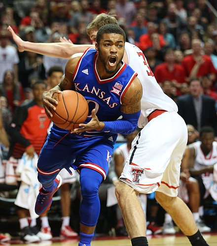 Kansas guard Frank Mason III (0) moves past Texas Tech forward Matthew Temple (34) as he looks for an outlet during the first half, Saturday, Jan. 9, 2016 at United Spirit Arena in Lubbock, Texas.