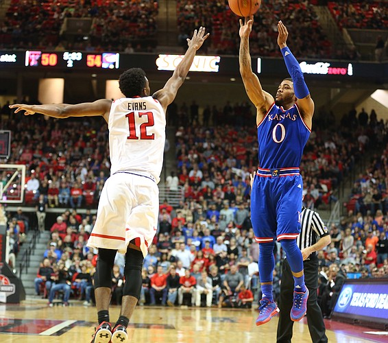 Kansas guard Frank Mason III (0) puts up a three over Texas Tech guard Keenan Evans (12) during the second half, Saturday, Jan. 9, 2016 at United Spirit Arena in Lubbock, Texas.